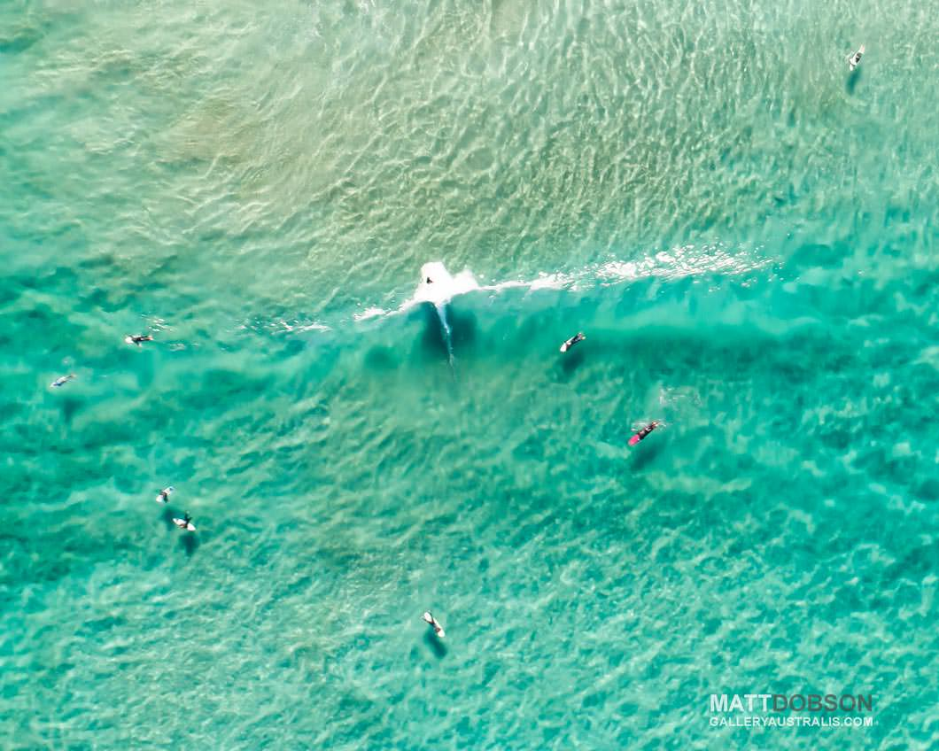 Wanda Beach Surfers surfing sand bank break, aerial photo.