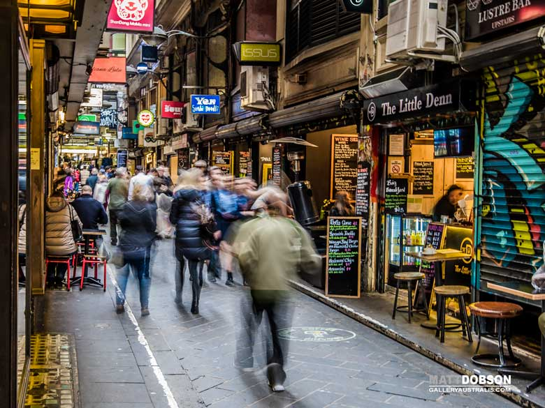People in one of Melbournes Laneway Cafes